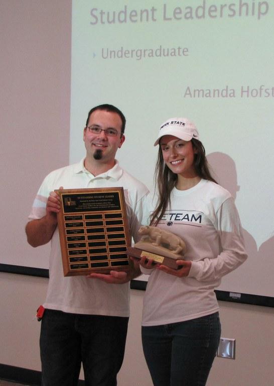 Andy Hirneisen, president, Food Industry Group, presents Amanda Hofstaedter with the Undergraduate Student Leadership Award