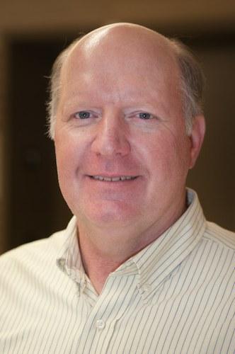 Edward W. Mills, Ph.D.